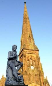 The familiar figure of poet Robert Burns in front of St Bride's