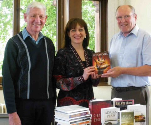 DCN donates Christian books to local libraries